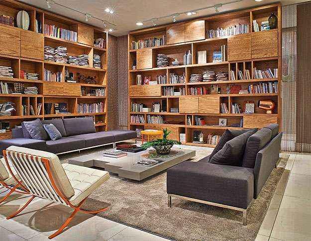 Se você tem muitos exemplares e espaço, o ideal é investir em uma grande estante para criar um visual descolado e organizado - Líder Interiores/Divulgação