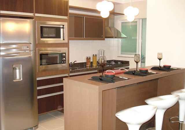 Nas cozinhas americanas, como são integradas com a sala, as composições desses ambientes precisam combinar - Reprodução/Internet