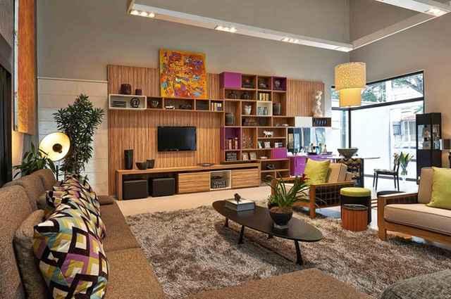 Loft pensado para um jovem contemporâneo integra de forma harmônica e moderna um grande living, sala de jantar e dormitório - Divulgação/Adriana Bellão