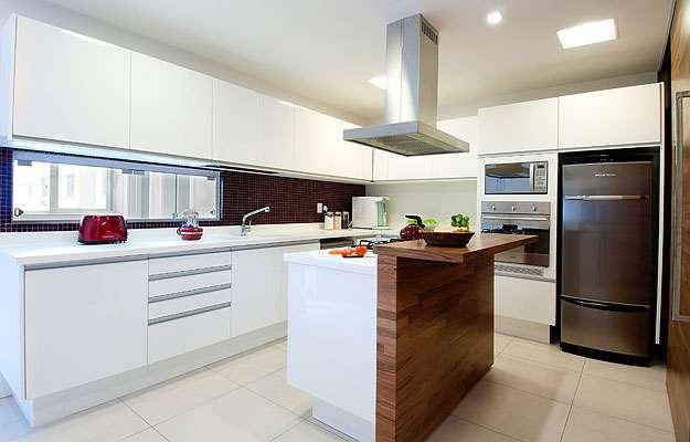 As cozinhas passaram a seguir o modelo americano, com bancadas em ilhas ou penínsulas e normalmente abertas para a sala, criando um extenso loft  - Arquivo Pessoal/Divulgação